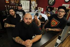 two tattoo parlors planned in elgin one meets opposition