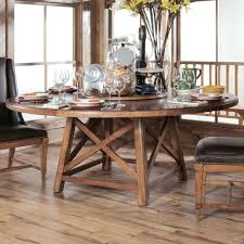 a large trestle table with x motif base pairs with upholstered