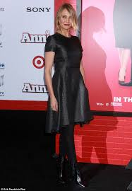 cameron diaz arrives to new york annie premiere in charcoal dress