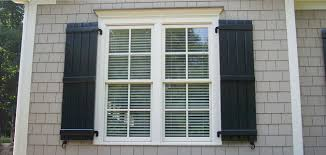 great photograph of suitable faux wood plantation shutters
