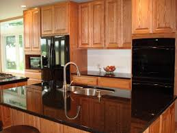 what color granite goes with honey oak cabinets small kitchen gray cabinets dark granite countertops with oak