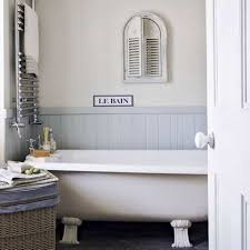country small space bathroom design with painted wainscoting and