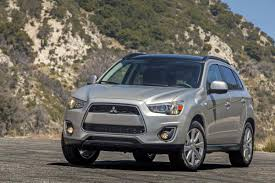 mitsubishi rvr interior review how mitsubishi u0027s rvr compares with the escape cr v and