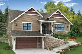 cut into the front side of a hill this craftsman style home