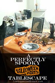 a perfectly spooky halloween party tablescape the organized dream