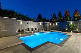 pool backyard landscaping ideas alongside modern pool with light