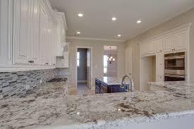 Kitchens With White Granite Countertops - traditional kitchen with ceramic tile u0026 complex granite counters