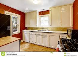 white kitchen cabinets with bright red wall stock photo image cabinets house kitchen old red wall white