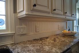 check out the beadboard backsplash also light rail molding added