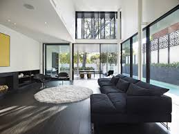 modern white wall glass house floor plans with black modern sofas