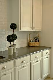 White Laundry Room Cabinets Reviving Brown Cabinetry With Paint The Colorful Beethe Colorful Bee