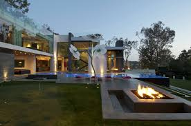 modern summit house in beverly hills outdoor fireplace and pool