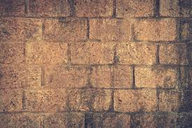 brown and brick wall close up shot photography free stock