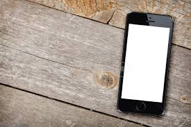 Wooden Table Smart Phone On Wooden Table Background With Copy Space Stock Photo