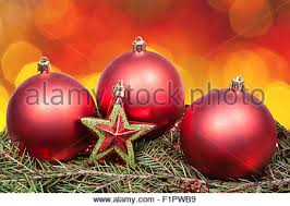 background of green and yellow lights and baubles stock photo