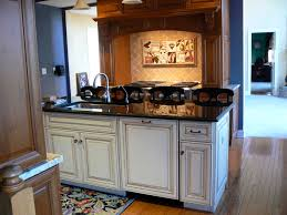 Black Glazed Kitchen Cabinets Wood Floors Black Granite Cream Glazed Cabinets And Stained Wood