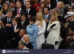 melania stands with the family during the national