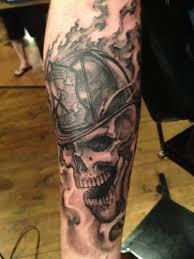 black ink firefighter skull design for forearm