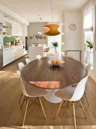 white armchairs round plates dark laminate flooring black brown