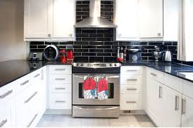 backsplash for black and white kitchen kitchen subway tiles are back in style 50 inspiring designs