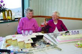 longtime friends golda beach and mary jane fenton toast each other