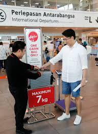 airasia liquid airasia reinforces carry on bag rules economy traveller