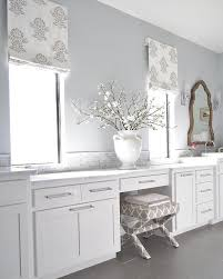 white and silver bathroom with fleur de lis shade