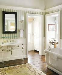 country bathroom ideas with striped wallpaper and console sink and