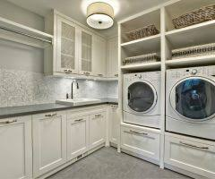 austin build laundry room cabinets traditional with black counter