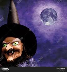 halloween background with purple scary halloween witch on grunge purple background and full moon