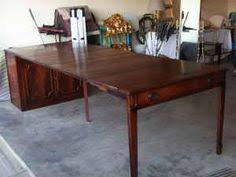 saginaw expandomatic buffet table saginaw expand o matic dining table with 6 chairs i really want one