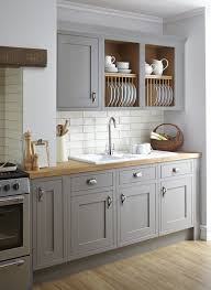light grey kitchen cabinets with wood countertops a kitchen with vintage grey kitchen cabinets and white tile