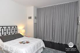 Ripplefold Draperies Wide Grey Ripplefold Curtains Installed In A Bedroom In Tempo