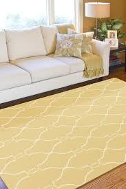 decorating yellow surya rugs on wooden floor plus white sofa plus