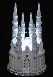 white glittered lighted cinderella diamond castle wedding