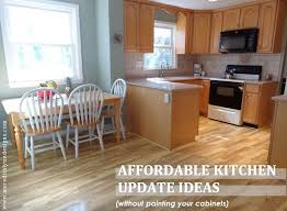 how to freshen up stained kitchen cabinets how to update your kitchen without painting your cabinets