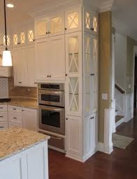 upper cabinets with glass doors tall white narrow cabinets top lit glass doors light counters
