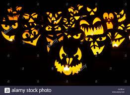 halloween pumpkins jack o lantern faces at night stock photo