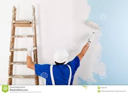 painting a wall painter painting a wall with paint roller stock photo image