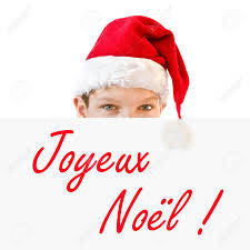 boy in santa hat and joyeux noel meaning merry