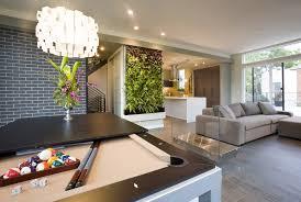 living room chrome flower pot green plant black futon sofa glass