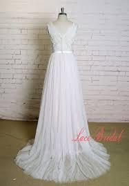 a line v neck wedding dress with blush underlay skirt sheer lace