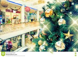 tree with gold decoration in shopping mall stock photo