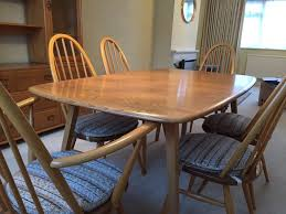 vintage ercol dining table and 6 chairs original 510 365 and