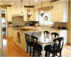 five kitchen island with seating design ideas on a budget 30 kitchen islands with tables a simple but very clever combo