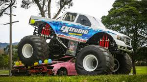 videos of monster trucks crushing cars video smell of methanol tops off monster jam night illawarra