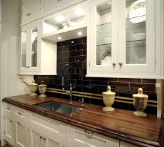 Dark Kitchen Cabinets With Light Granite Backsplashes Kitchen Granite Countertops Images Black Cabinets