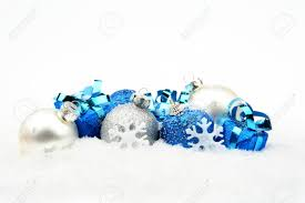 Christmas Decorations In Blue And Silver decoration of blue silver christmas baubles and gifts on snow