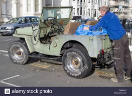 modified jeep man loading bags in to modified jeep stock photo royalty free