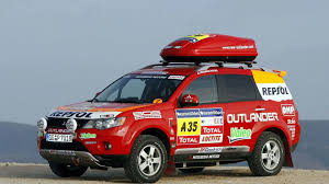 red mitsubishi outlander mitsubishi outlander supports dakar 2008